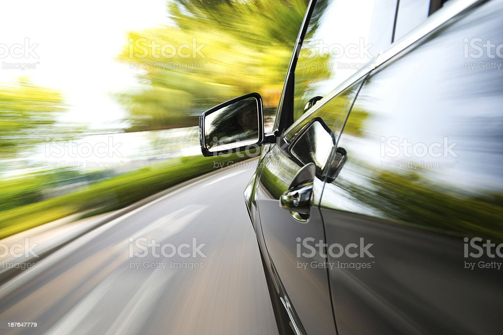 driving fast stock photo