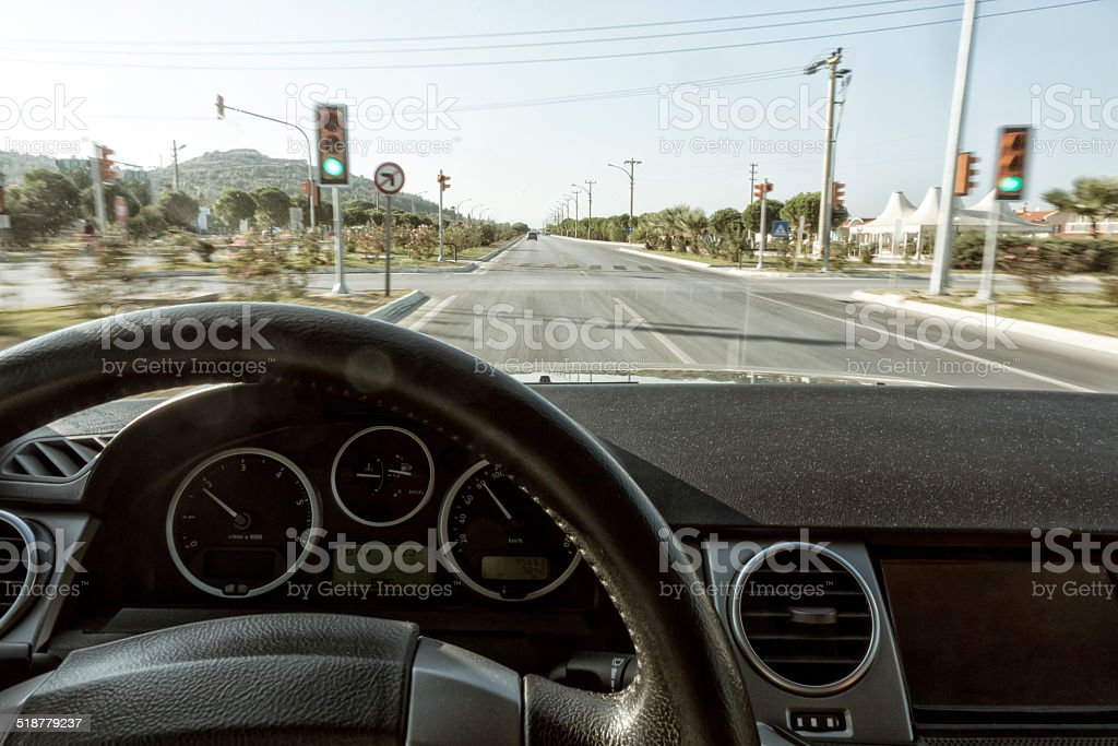 driving fast through green lights stock photo