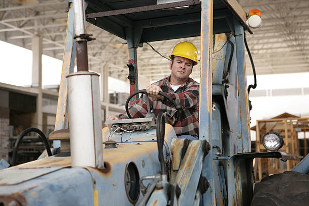 driving heavy equipment - switchboard operator stock photos and pictures