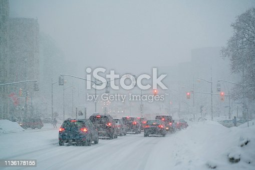 1127834626 istock photo Driving in a Snow Storm 1136178155