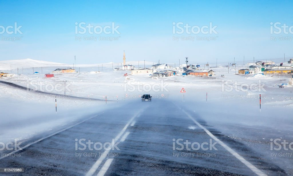 Driving in blizzard stock photo