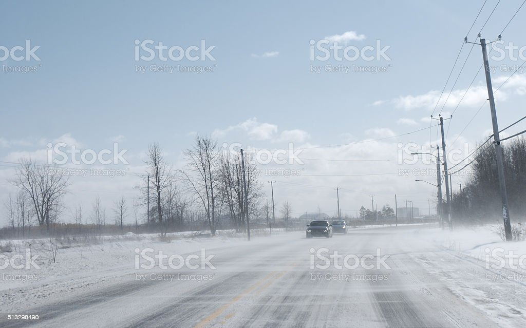 Driving in blizzard. stock photo