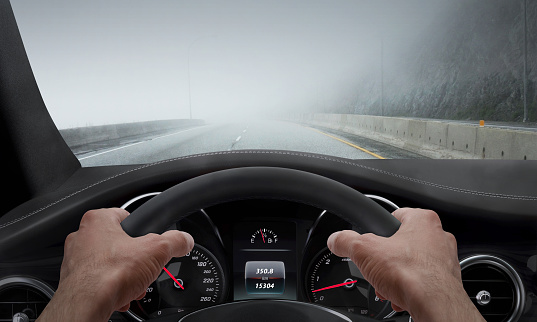 Driving in fog weather. View from the driver angle