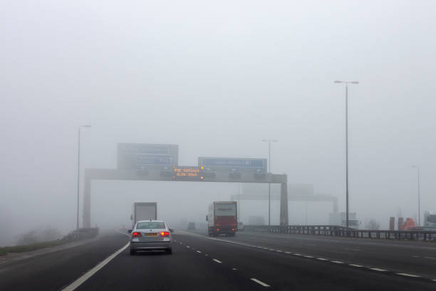 Driving in foggy conditions on a British motorway stock photo
