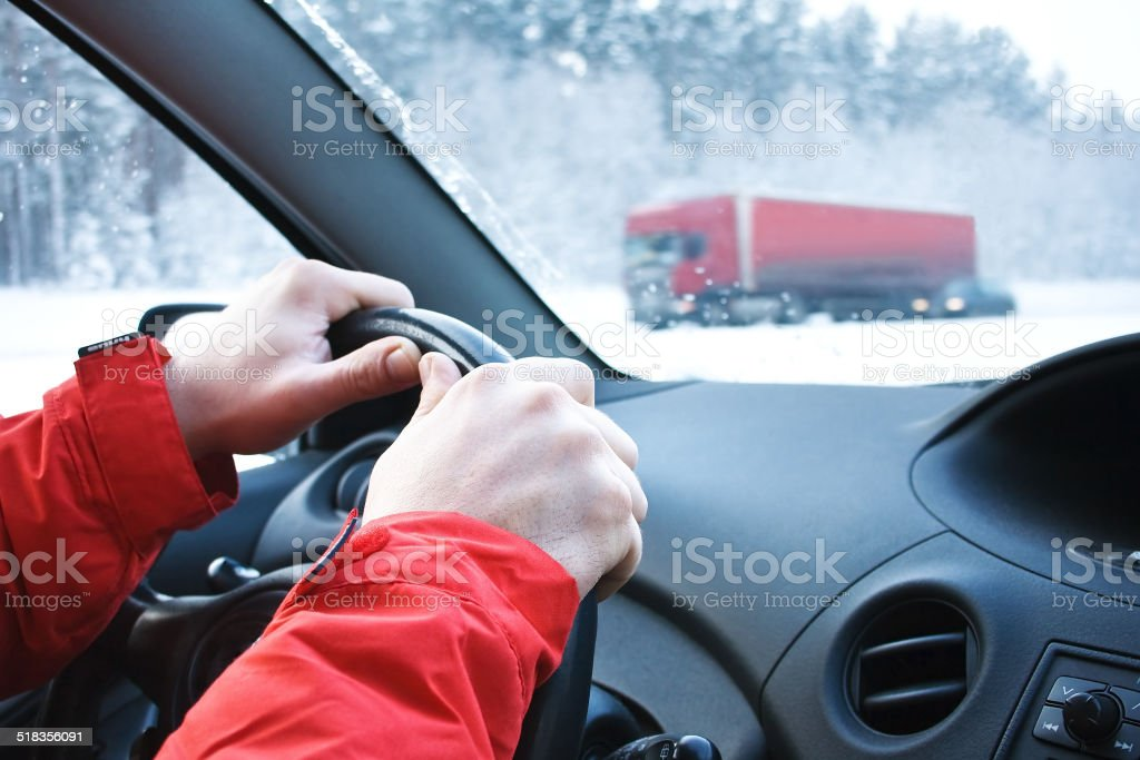 Driving in snowfall stock photo