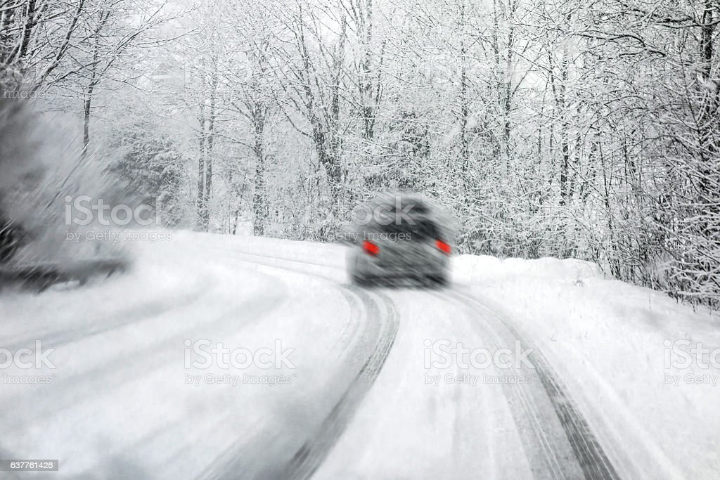 Driving in snowstorm stock photo