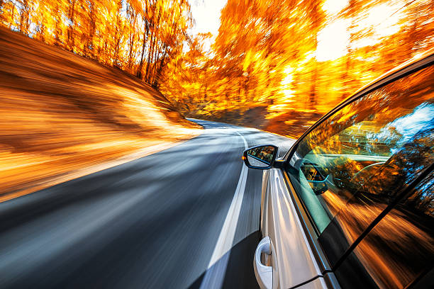 driving in the fall - saturated color stock pictures, royalty-free photos & images