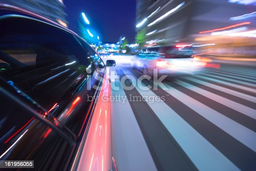 157590217 istock photo Driving in the night city. 161956055