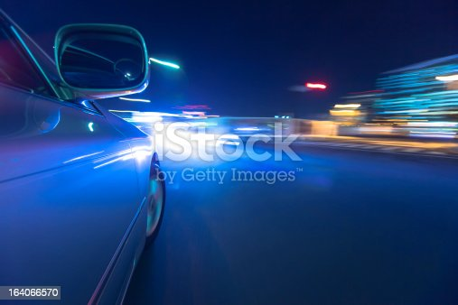 157590217 istock photo Driving in the night city. 164066570