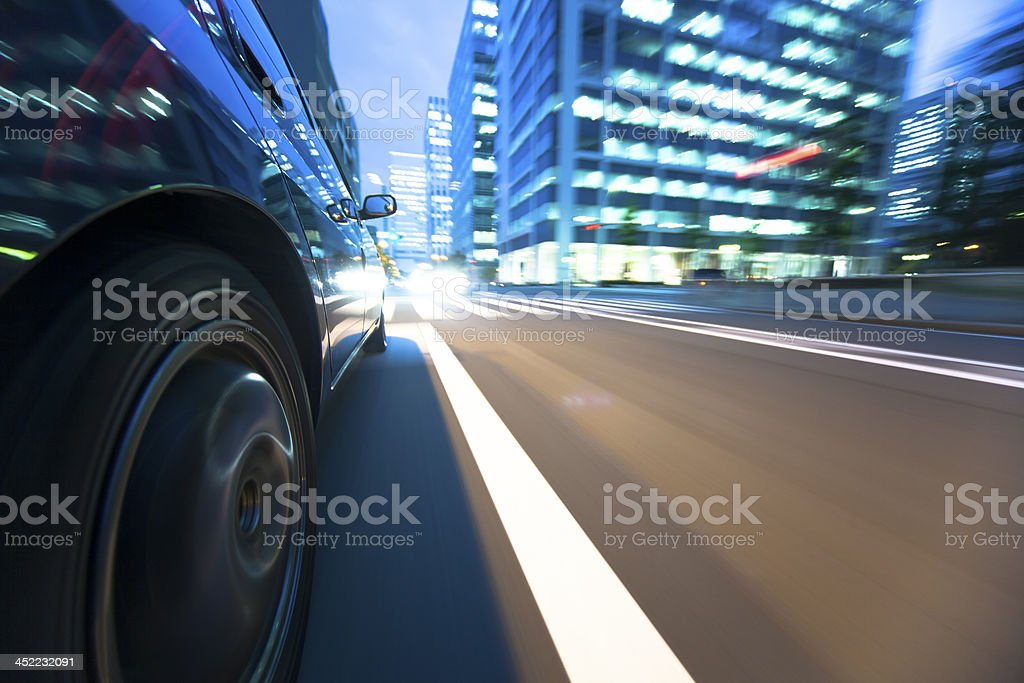Driving in the sunset city. royalty-free stock photo
