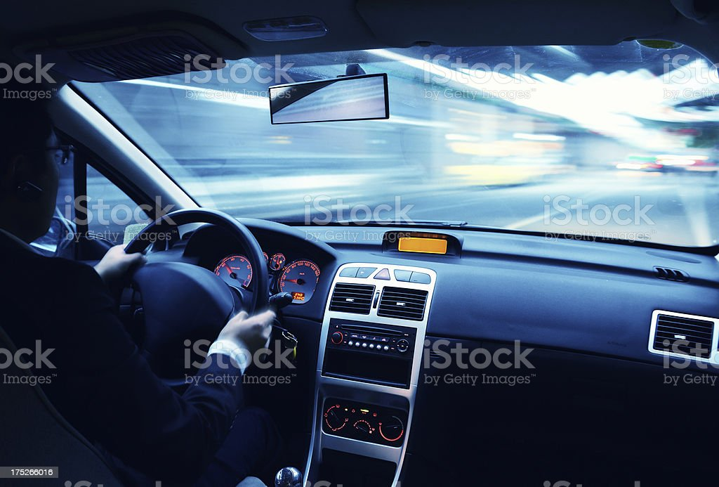 Driving in urban scene stock photo