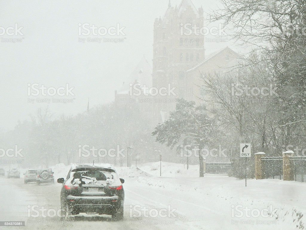 Driving in winter during snow storm stock photo
