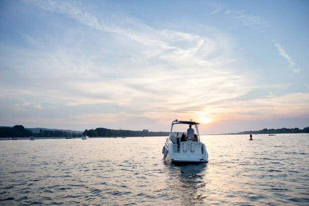 Driving into the sunset. Yacht from behind. nautical vessel stock pictures, royalty-free photos & images