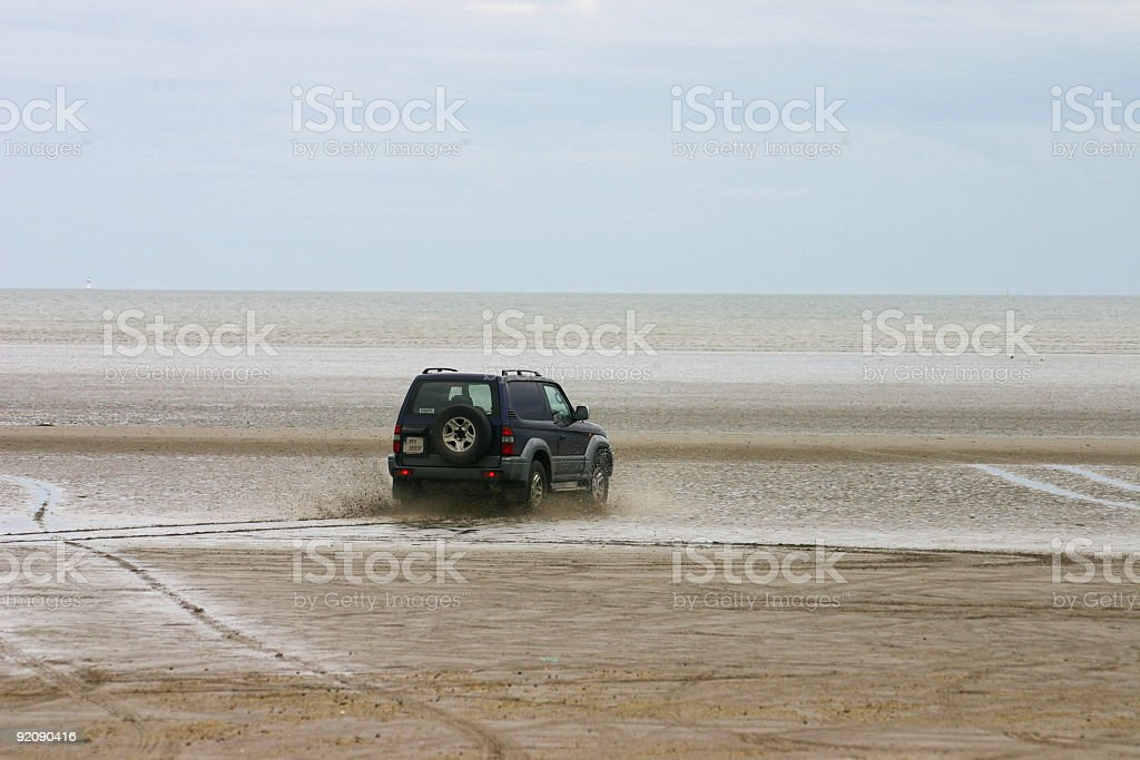 Driving  jeep on a beach royalty-free stock photo