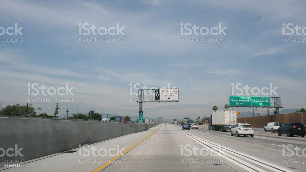 Driving POV Los Angeles Freeway 4k royalty-free stock photo