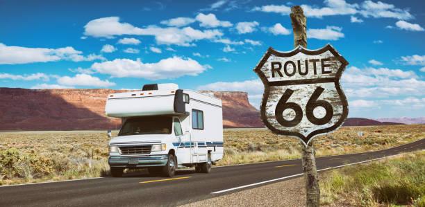 camper door usa national park op route 66 rijden - arizona highway signs stockfoto's en -beelden