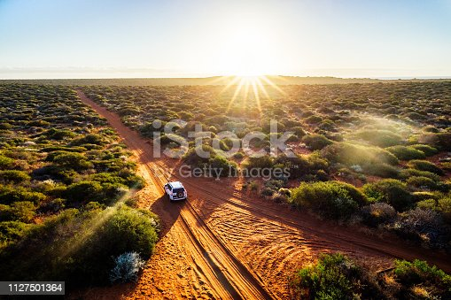Driving off-road in Western Australia at sunset, aerial view. Francois Peron National Park