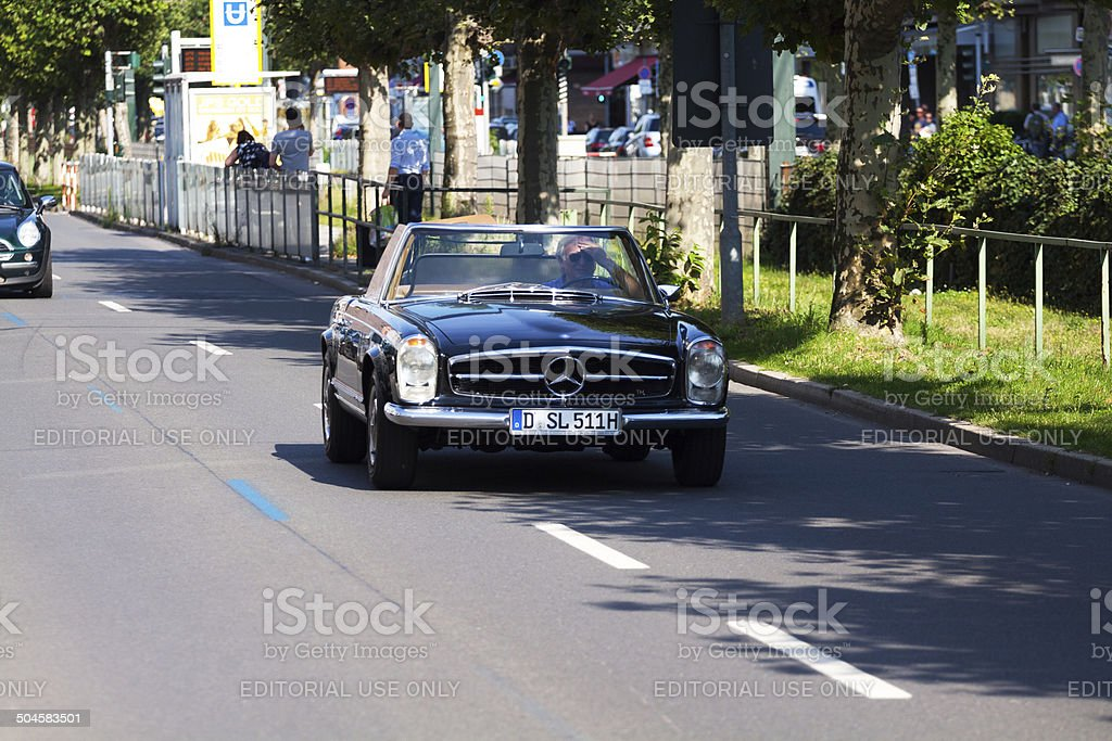 Driving old Mercedes SL 280 convertible car stock photo