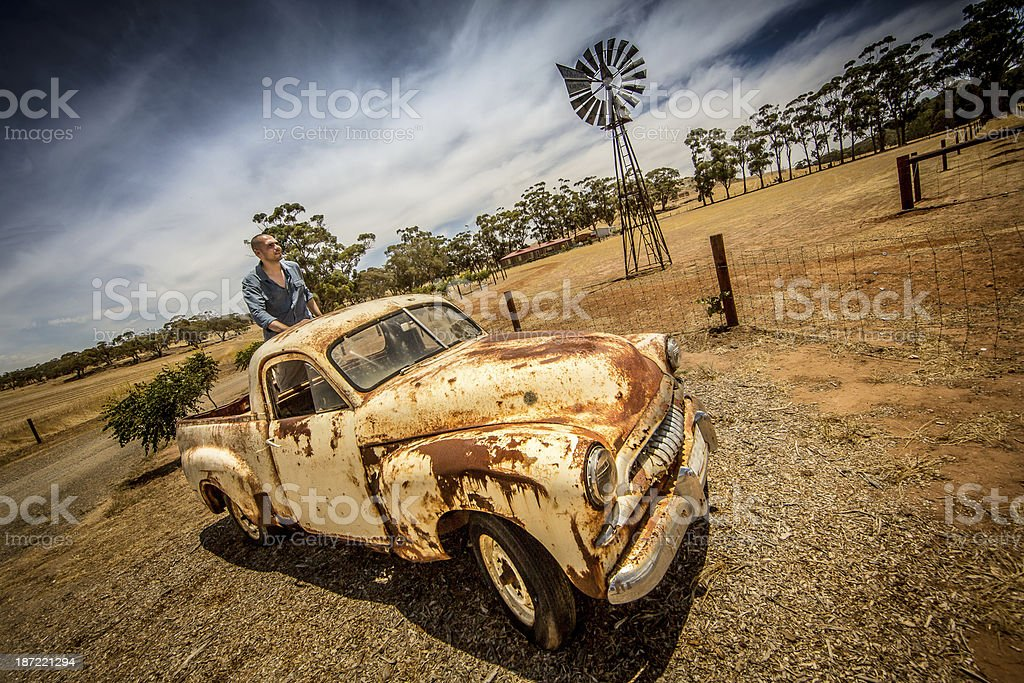Driving old rusty car in the outback royalty-free stock photo
