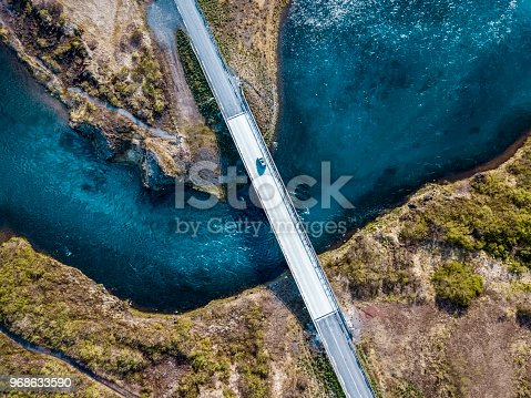istock Driving on a bridge over deep blue water 968633590