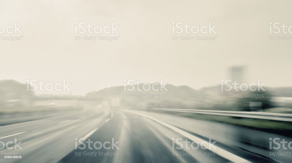 Driving on a Freeway on a Rainy and Misty Day stock photo