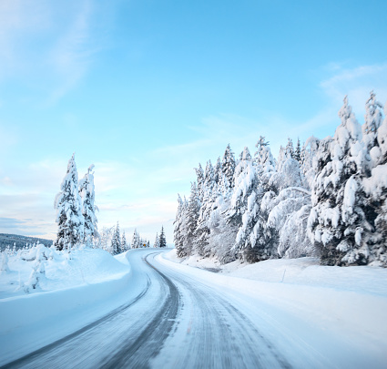 Driving on a slippery road in January, Oppland County Norway