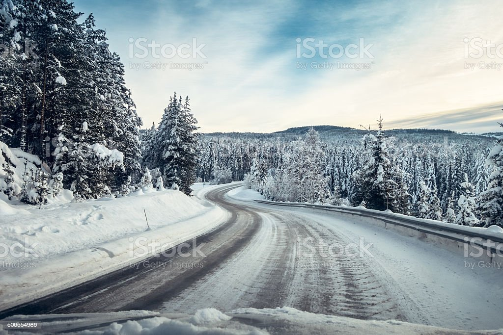 Driving on a slippery road in January, Oppland Norway stock photo