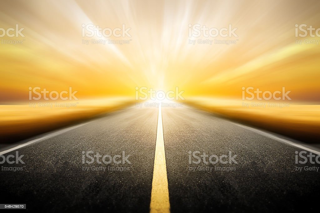 Driving on an blurred empty asphalt road twilight sky stock photo