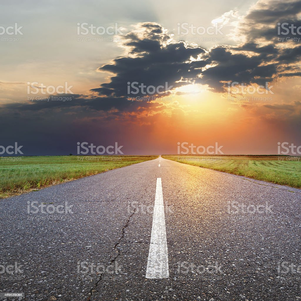 Driving on an empty asphalt road at dusk stock photo
