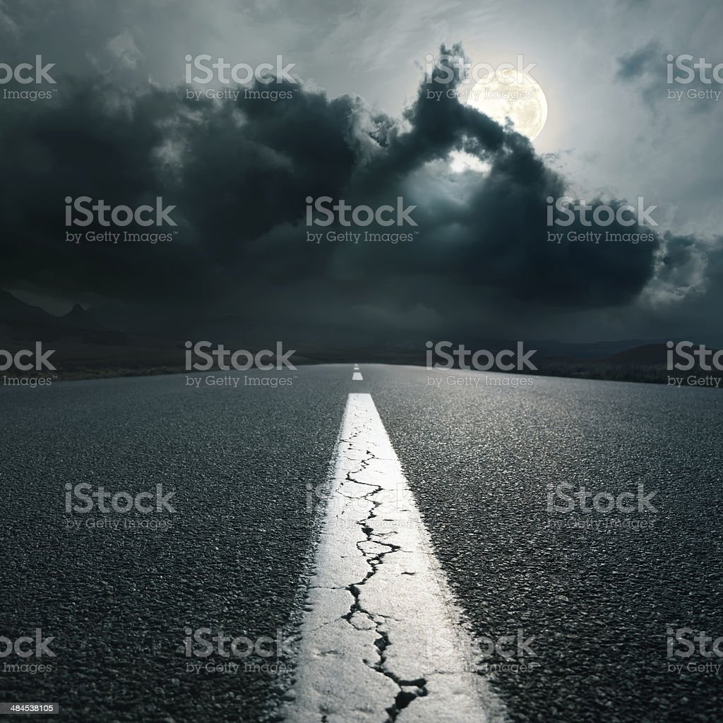 Driving on an empty asphalt road at night stock photo