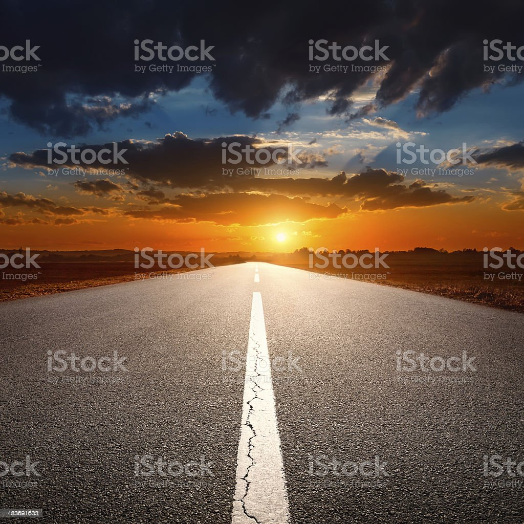 Driving on an empty asphalt road at sunset stock photo