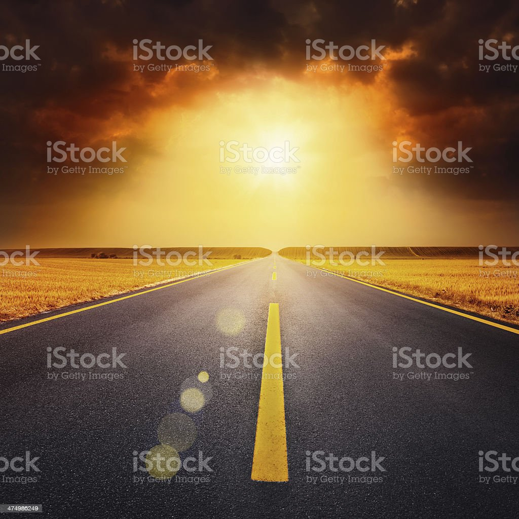 Driving on an empty highway through the wheat fields stock photo