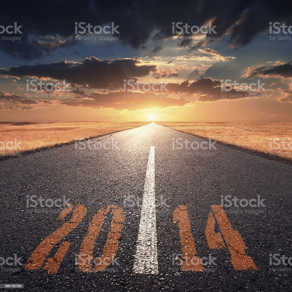 Driving on an empty road towards the setting sun 2014 royalty-free stock photo