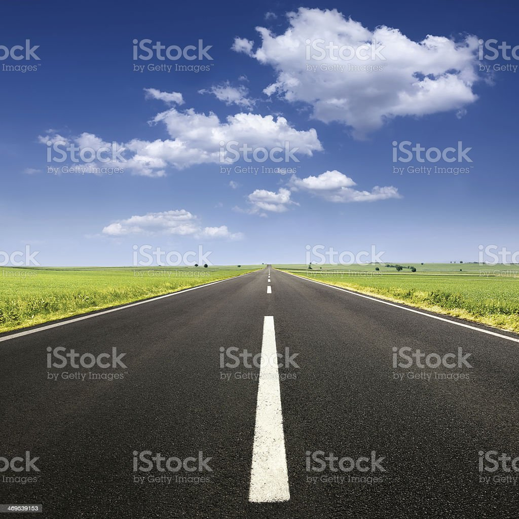 Driving on asphalt road at nice sunny day stock photo