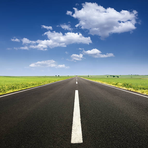 driving on asphalt road at nice sunny day - straight stock photos and pictures