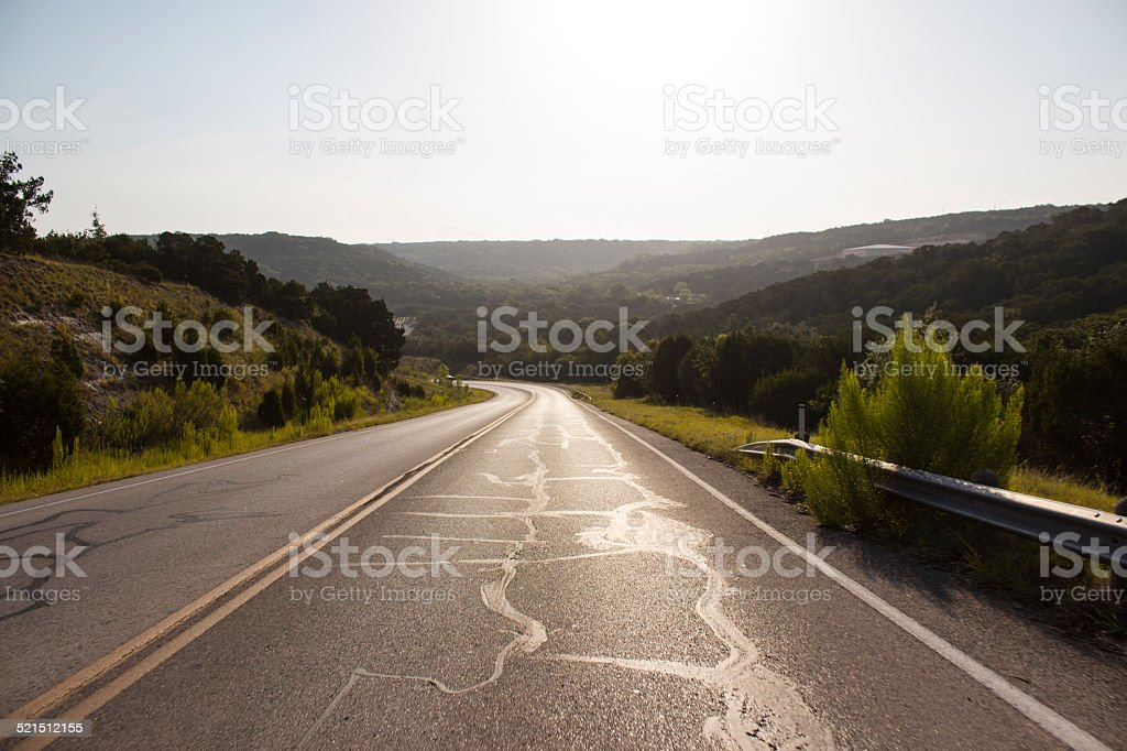 Driving on empty road stock photo