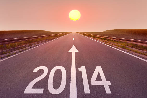 Driving on empty road towards the setting sun 2014 Forward to new 2014 on the road 2014 stock pictures, royalty-free photos & images