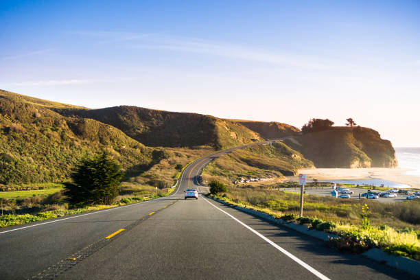 driving on highway 1 on the pacific ocean coastline close to half moon bay, california - coastline stock pictures, royalty-free photos & images