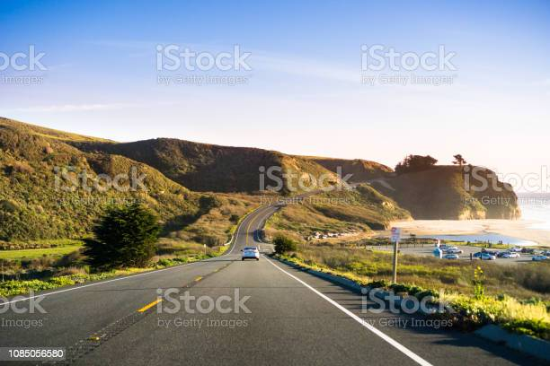 Photo of Driving on Highway 1 on the Pacific Ocean coastline close to Half Moon Bay, California