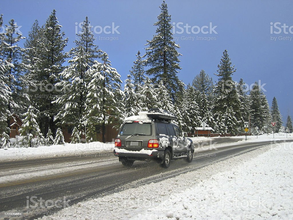 "SUV Driving On Snowy Road ""Winter forest scene near Truckee, Lake Tahoe, California, USA."" Blurred Motion Stock Photo"