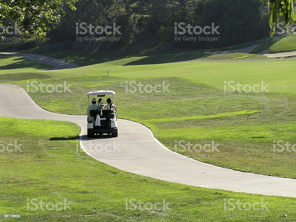 driving on the fairway stock photo