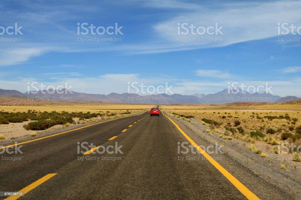 Driving on the high altitude desert road of Atacama desert in San...