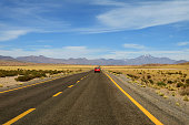 Driving on the high altitude desert road of Atacama desert in San Pedro de Atacama, northern Chile, South America