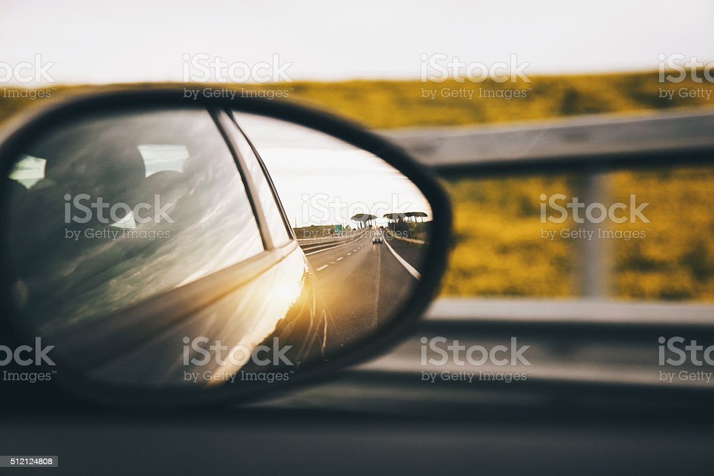 Driving on the road at sunset stock photo