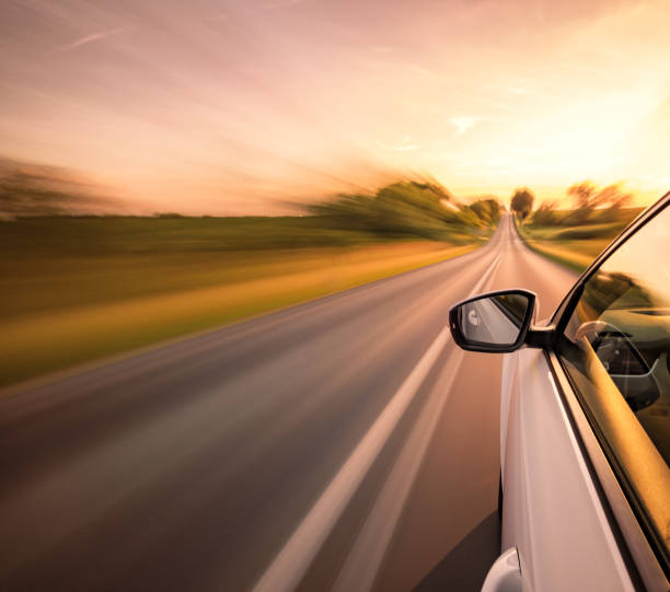 Driving on the road Driving on a beautiful spring day. land vehicle stock pictures, royalty-free photos & images