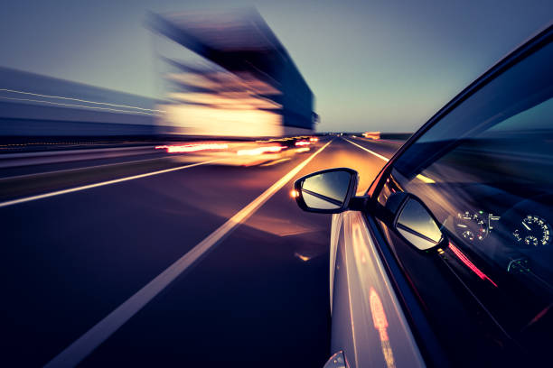 Driving on the road Driving on a motorway saturated color stock pictures, royalty-free photos & images