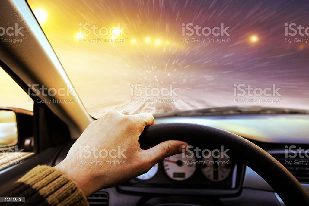 Driving on winter road stock photo
