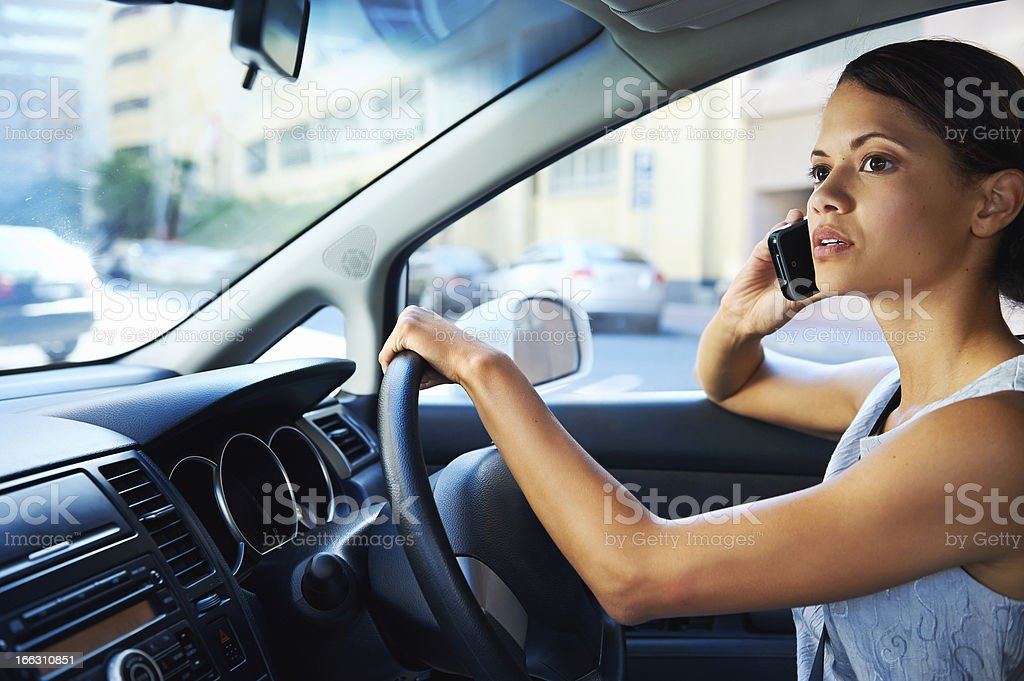driving phone woman royalty-free stock photo