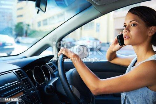istock driving phone woman 166310851