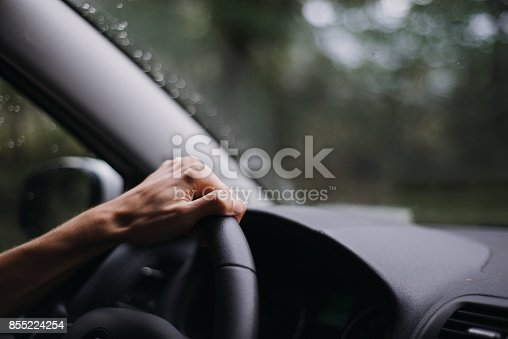 Driver is driving in a cloudy day. Driving in a bad weather with rain.